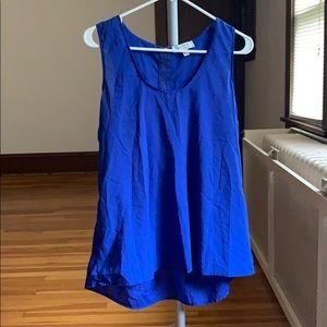 Bright blue sleeveless work blouse with zipper